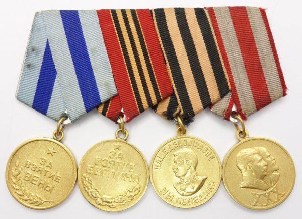 Four Soviet Medals on bar